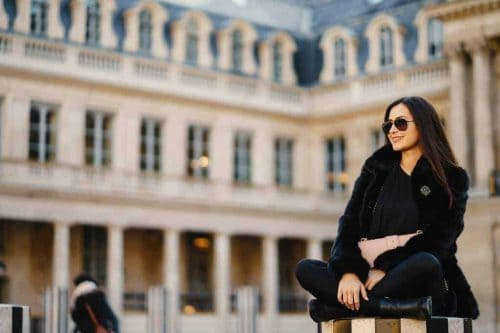girl sitting at a landmark in paris
