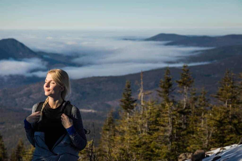 Woman Enjoying the Fresh Air of the Mountains while Hiking to th