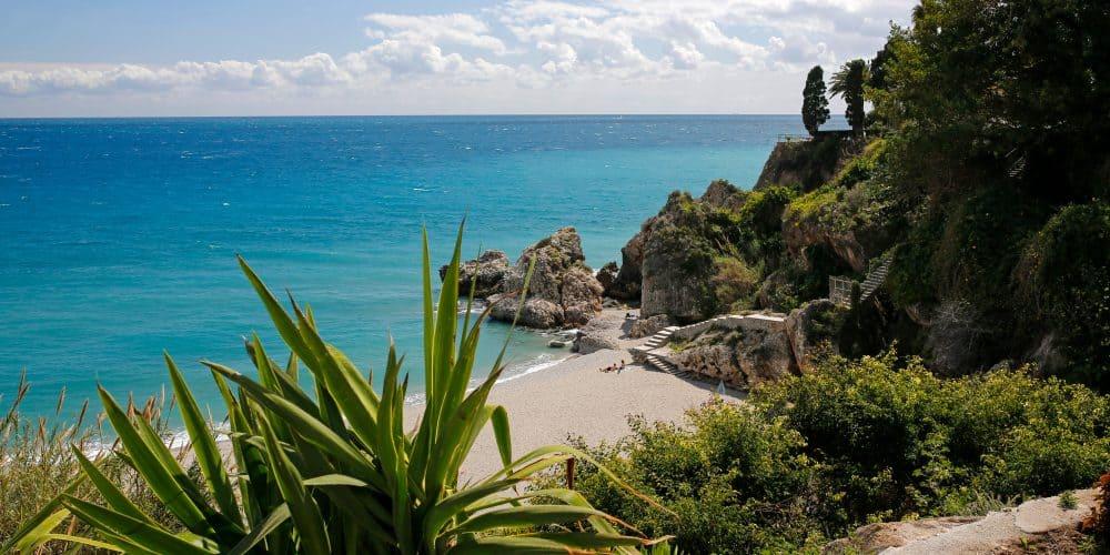 Canva Carabeillo Beach In Nerja Costa Del Sol Spain 1000x500
