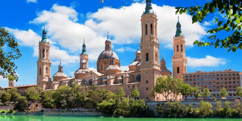 Canva Cathedral and Ebro river in Zaragoza. Aragon Spain 1000x500 - Andalucia Levante- 7 Días / 6Noches