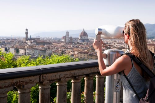 tourist enjoys awesome views offered by the city of florence t20 W7RGAY min 500x333 - Euroexpress 17 días